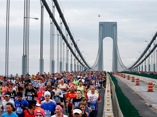 Runners cross the Verrazano-Narrows Bridge at the start of the New York City Marathon, Sunday, Nov. 1, 2015, in New York.
