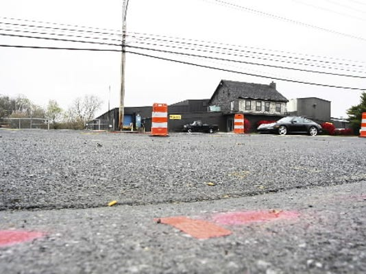 Pink paint shows a 2-inch depression that reappeared Wednesday on Route 422 in North Londonderry Township.