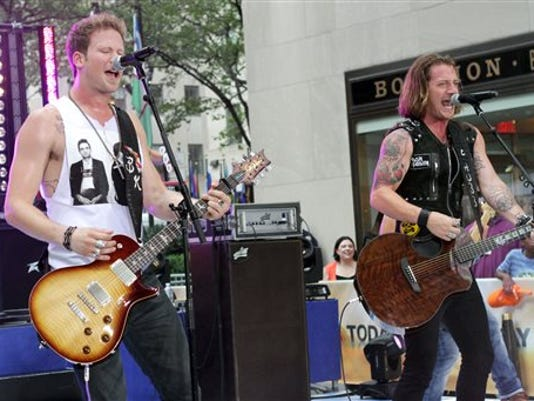 """Brian Kelley, left, and Tyler Hubbard, of musical group Florida Georgia Line, perform on NBC's """"Today"""" show in New York."""