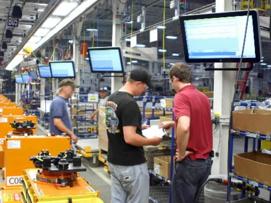 Harley-Davidson's renovated plant includes a new way motorcycles are assembled -- on carts that follow magnetic tape on the floor, instead of on conveyor belts anchored in concrete -- and is designed to give the plant flexibility in what it can produce.
