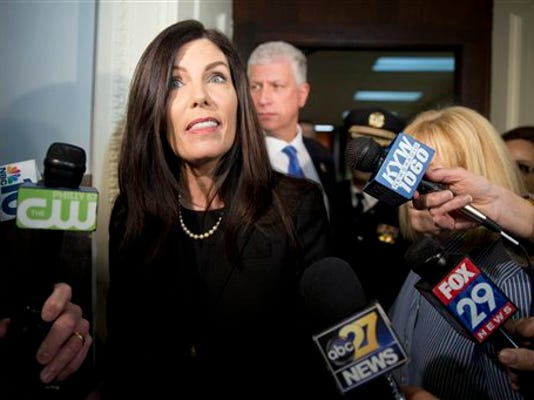 In this file photo, Pennsylvania Attorney General Kathleen Kane walks from the state Supreme Court room on March 11, 2015, after a grand jury recommended charges against her.
