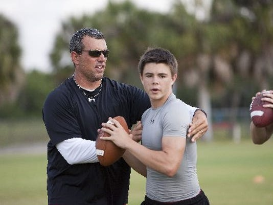 Quarterback Cody Young at a Lely football practice in 2013. PHOTO BY JASON EASTERLY