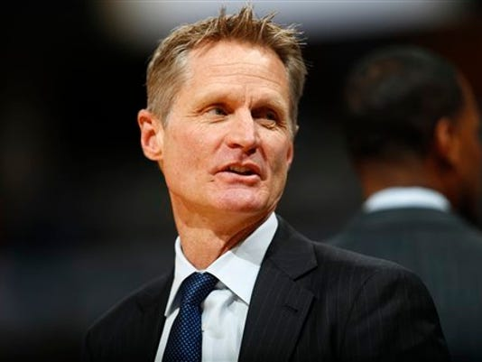 FILE - In this Feb. 13, 2017, file photo, Golden State Warriors head coach Steve Kerr looks on in the first half of an NBA basketball game against the Denver Nuggets in Denver. Ailing Kerr attended the Warriors' practice Saturday morning, May 13, 2017, returning to the floor for the first time in more than three weeks. (AP Photo/David Zalubowski, File)
