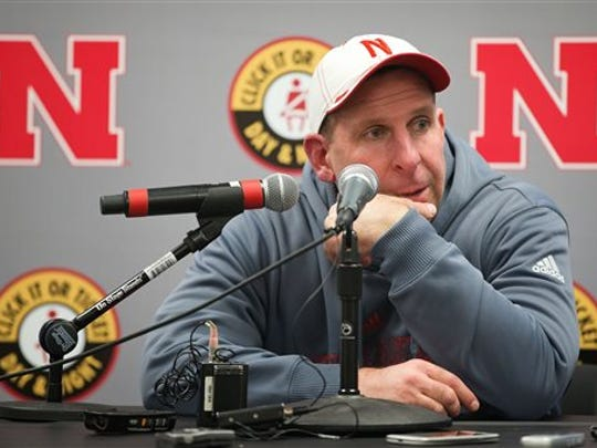 Nebraska coach Bo Pelini answers questions after beating Iowa on Friday, the last game he coached before his firing.