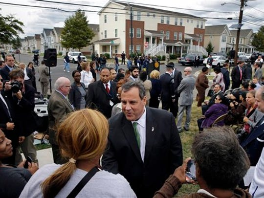 Gov. Chris Christie greets residents at a gathering in Camden last September. Christie has made frequent stops in the high-crime city, stressing his efforts working with local Democratic lawmakers, including Mayor Dana Redd. Under Christie, New Jersey has paid more than $2 billion in state tax breaks since 2014, often to corporations with notable political connections and at least one developer who already owed millions of dollars in unpaid state loans, an Associated Press review found.
