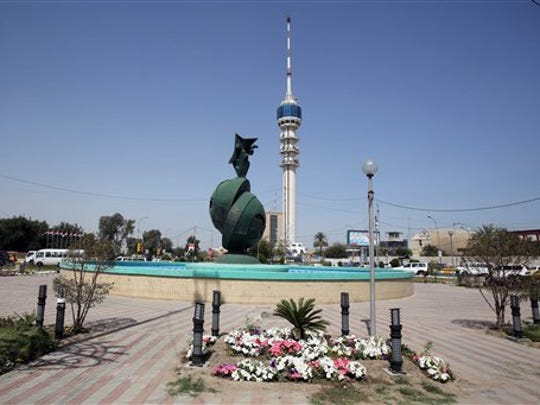 Spring flowers are planted in Baghdad's Nisour Square, the site of a deadly shootout by Blackwater private security contractors in 2007. On Monday, contractor Nicholas Slatten convicted of murder and sentenced to life in prison, while Paul Slough, Evan Liberty and Dustin Heard were convicted of manslaughter and received sentences of 30 years plus one day. Seventeen civilians were killed and 20 were injured.