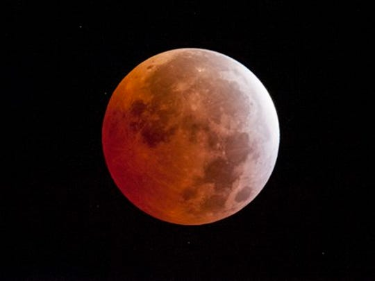 A lunar eclipse is seen on Saturday in Placerville, Calif. Early risers in the western U.S. and Canada should have been able to catch a glimpse before dawn Saturday. The moment when the moon was completely obscured by Earth's shadow lasted only a few minutes, making it the shortest lunar eclipse of the century.