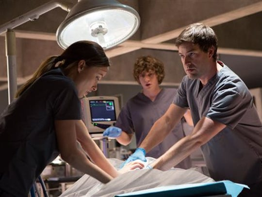 """In this image released by Relativity Media, Olivia Wilde, from left, Evan Peters and Mark Duplass appear in a scene from """"The Lazarus Effect"""". (AP Photo/Relativity Media, Justin Lubin)"""