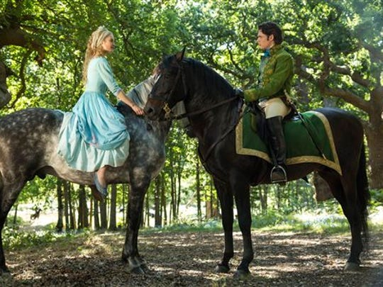 Cinderella ( Lily James) and the prince (Richard Madden) meet for the first time in Disney's live-action Cinderella.