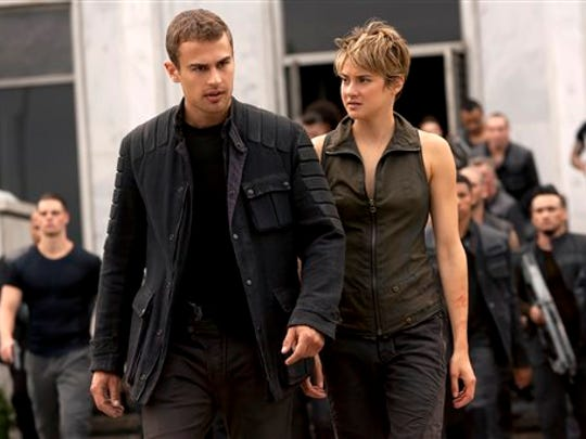 "Theo James, left, and Shailene Woodley in a scene from ""The Divergent Series: Insurgent."""