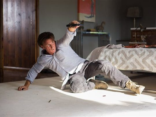 "Sean Penn iis an ex-mercenary on the run in ""The Gunman."""