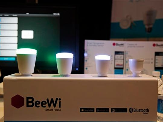 BeeWi wirelessly controlled lights are on display at CES Unveiled, a media preview event for CES International, Sunday, Jan. 4, 2015, in Las Vegas. (AP Photo/John Locher)