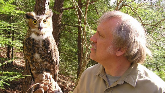 "Carlton Burke with an ""owl ambassador."""