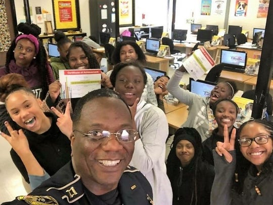 Capt. Darwin Jones of the Caddo Parish Sheriff's Office, with Fair Park Academy eighth-graders he instructed as part of a Junior Achievement class in the fall of 2017.