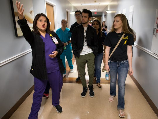 Nurse Eva Torrez leads a group of Branch Academy for Career and Technical Education seniors through a tour of Christus Spohn Hospital South's maternity floor on Thursday, May 25, 2017.