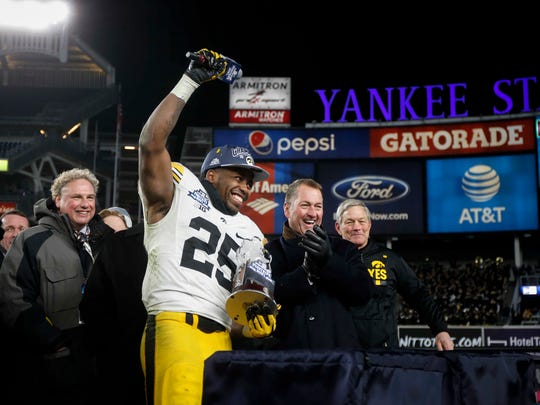 Akrum Wadley was named MVP of the Pinstripe Bowl in his final game as an Iowa running back. Wadley wrote Monday that he was treated so poorly by some coaches during his Hawkeye career that he now regrets ever playing there.