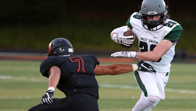 West Salem's Noah Whitaker runs the ball as the Titans defeat Sprague 36-29 in a Greater Valley Conference game on Friday, Sept. 9, 2016, at Sprague High School.