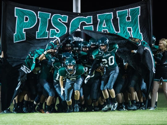 The Pisgah Dragons enter the field during the Puckett