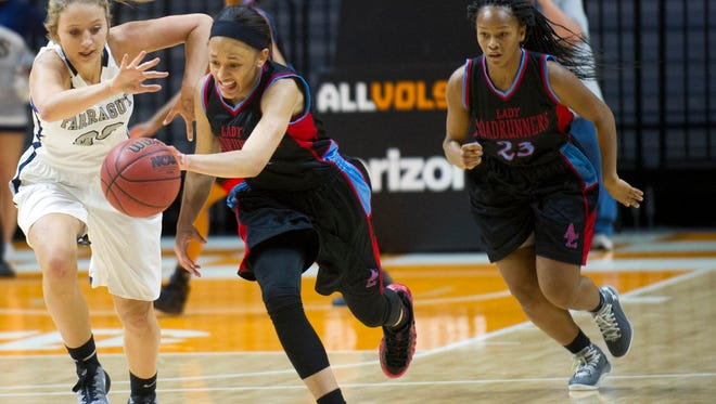 Austin-East's Larriana Bullard steals the ball from Farragut's Brooke Christian during the Tennova Tip-Off Classic at Thompson-Boling Arena on Wednesday, November 9, 2016.