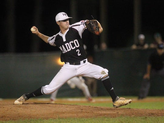 Madison County's Drew Herring pitches in relief against