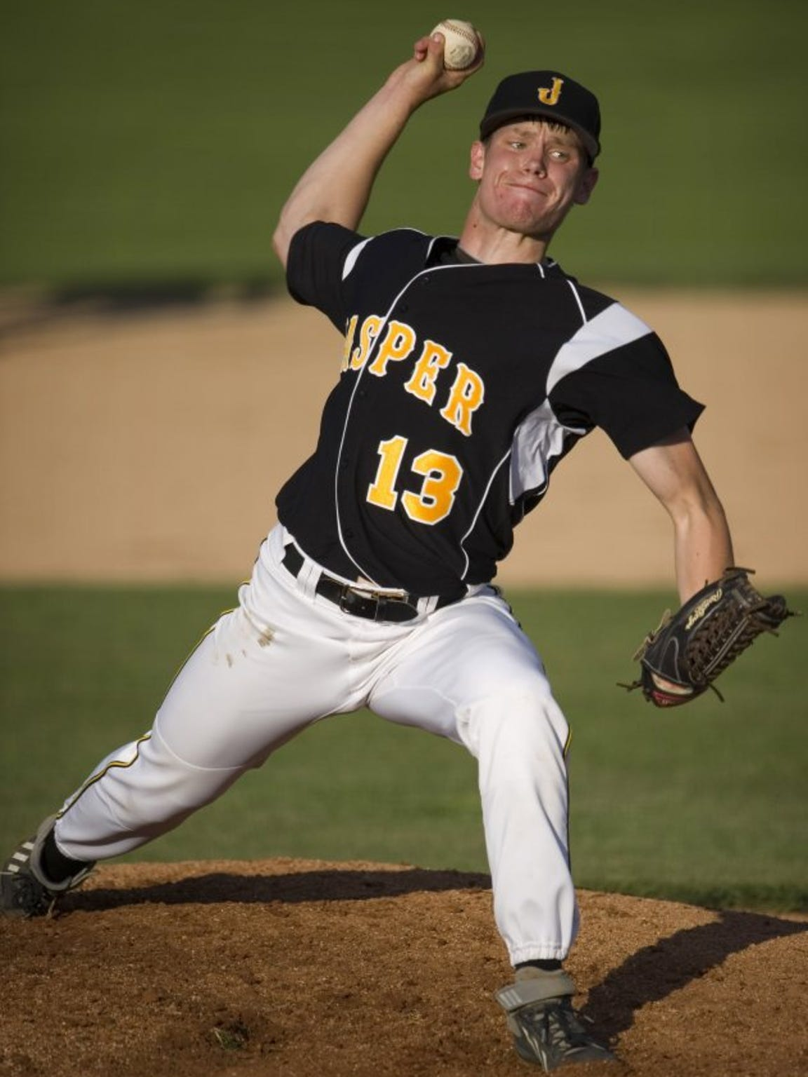 Cal Krueger delivers a pitch as a Jasper Wildcat, where