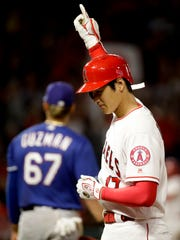 Los Angeles Angels' Shohei Ohtani, of Japan, celebrates after hitting an RBI single against the Texas Rangers during the sixth inning of a baseball game in Anaheim, Calif., Tuesday, Sept. 25, 2018. (AP Photo/Chris Carlson)