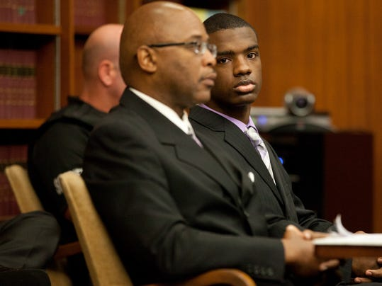 Assistant Washtenaw County Public Defender Lorne Brown, left, and Ed Thomas, right, listen to an opening statement in Thomas' trial at the Washtenaw County Trial Court in Ann Arbor, Mich., on Wednesday, July 23, 2014. Thomas is on trial for the fatal shooting of Eastern Michigan University football player Demarius Reed.  (AP Photo/The Ann Arbor News, Patrick Record) LOCAL TELEVISION OUT; LOCAL INTERNET OUT