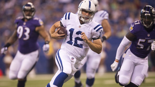 Andrew Luck scrambles on this first quarter keeper, Colts vs. Baltimore Ravens, preseason at Lucas Oil Stadium, Saturday, Aug. 20, 2016.
