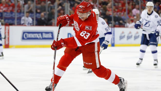 Detroit Red Wings left wing Tomas Nosek (83) shoots against the Tampa Bay Lightning in the second period of an NHL hockey game Friday, March 24, 2017, in Detroit.