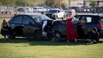 Willow Canyon High School students act out a scene involving a drunk and distracted driver at a mock crash event in March 2018.
