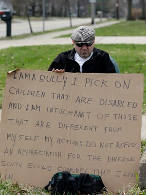 "Edmond Aviv sits on a street corner holding a sign Sunday in South Euclid, Ohio declaring he's a bully, a requirement of his sentence because he was accused of harassing a neighbor and her disabled children for the past 15 years. Municipal Court Judge Gayle Williams-Byers ordered Aviv, 62, to display the sign for five hours Sunday. It says: ""I AM A BULLY! I pick on children that are disabled, and I am intolerant of those that are different from myself. My actions do not reflect an appreciation for the diverse South Euclid community that I live in."""