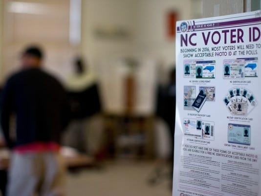 636060018839022416-AP-Voter-ID-Lawsuit-NCGRE502.jpg