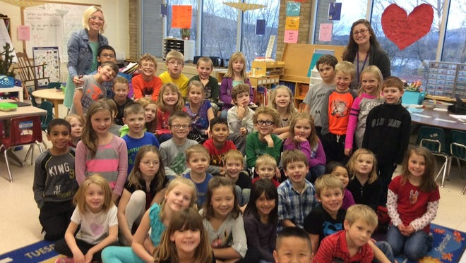 Brooke Wendorf, back left, teaches first grade at Rothschild Elementary.