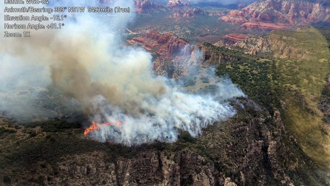 Point Fire burns about 3 miles south of Sedona in the Coconino National Forest.