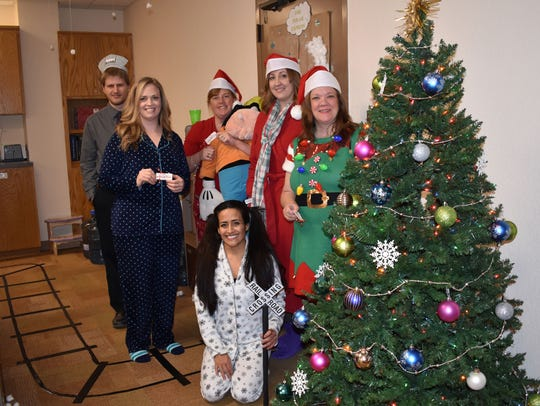 "First National Bank Operations Department decorated their office as ""The Polar Express."""