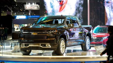 Detroit auto show highlights industry's balancing act