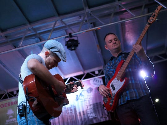 Dave Tate and Ryan Tilby of Many Miles perform during the George Streetfest in downtown St. George.
