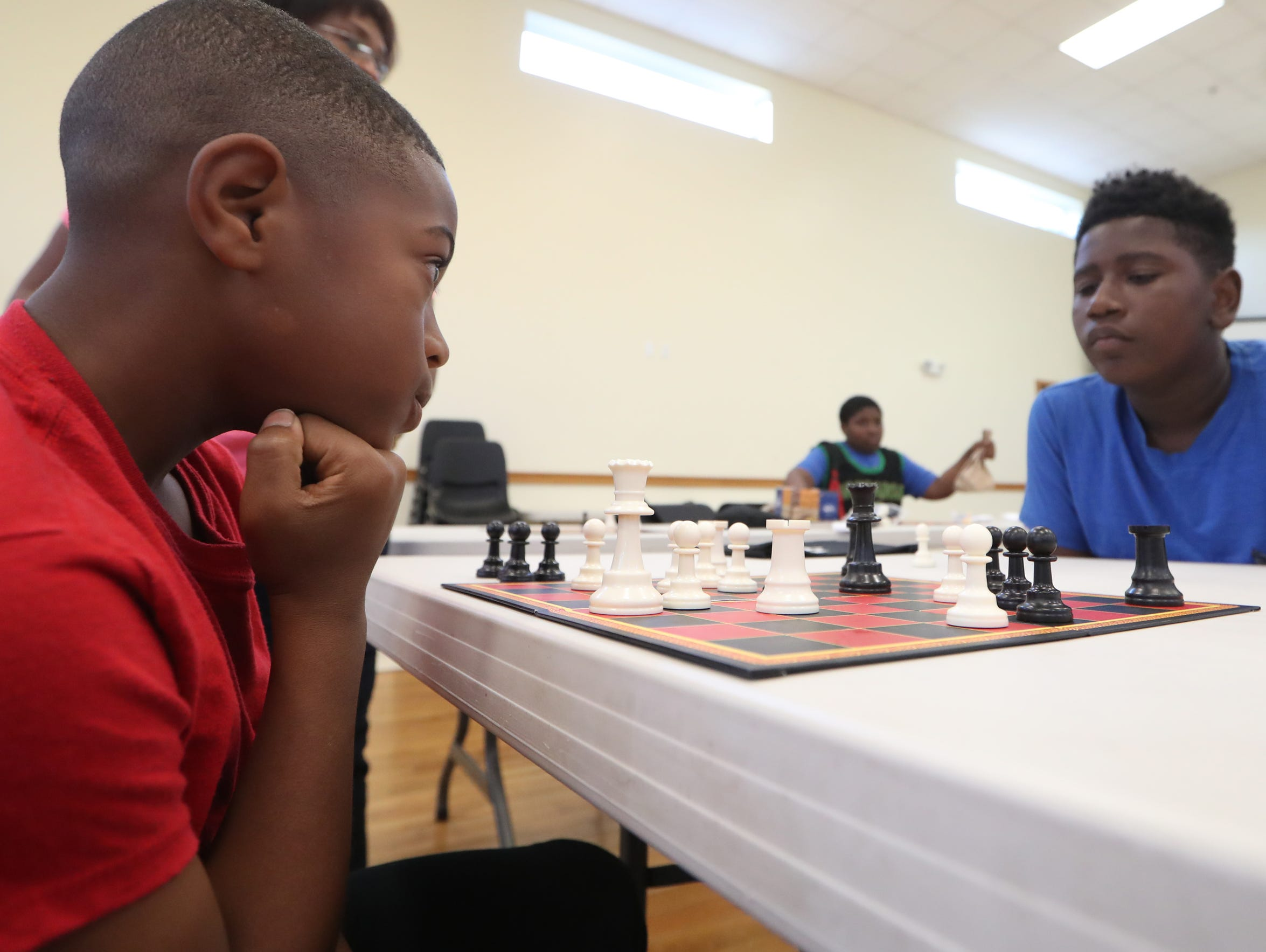 Alan Wilson, 9, plays a game of chess with Jaylan Smith,
