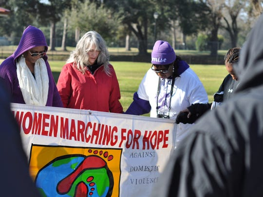 Denise Wolford (right), founder of All Women Marching for Hope, leads a group of Central Louisiana residents in prayer Saturday morning before the organization's 6th annual march in Alexandria.