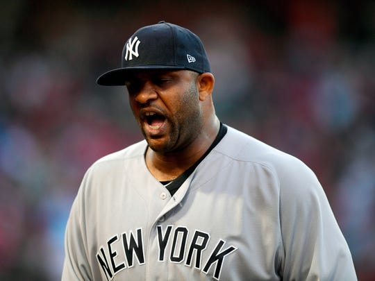 New York Yankees starting pitcher CC Sabathia yells as he gets out of the fourth inning after giving up one run.
