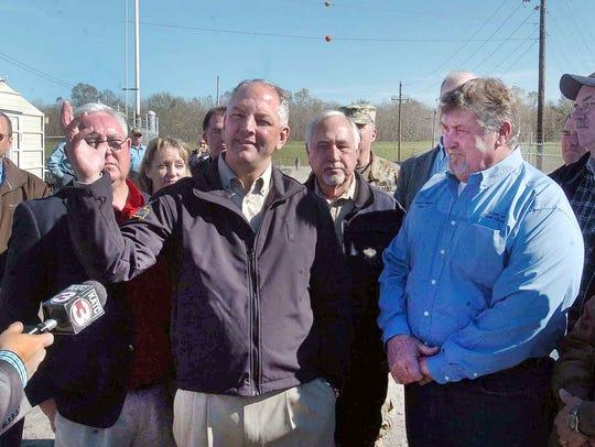 Louisiana Governor John Bell Edwards talks with members