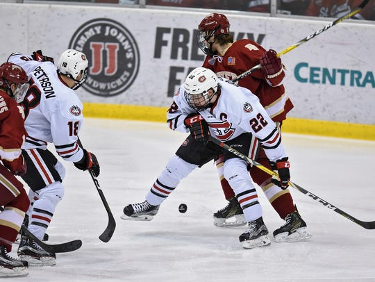 The puck bounces past Jimmy Schuldt of St. Cloud State