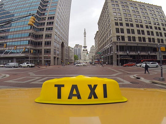 The view of Monument Circle from the top of a taxi