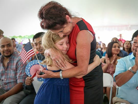 Linda Thomson, who comes from Scotland, hugs granddaughter