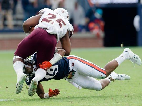 Auburn defensive back Nick Ruffin (19) tackles Louisiana