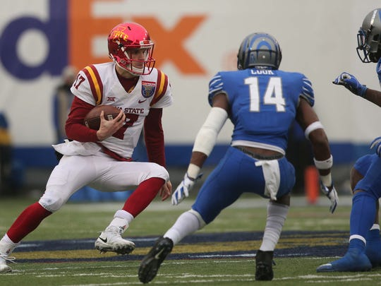 Iowa State Cyclones quarterback Kyle Kempt (17) runs upfield under pressure from Memphis Tigers defensive back Jonathan Cook (14) during the second half of the AutoZone Liberty Bowl Saturday, Dec. 30, 2017, in Memphis, Tennessee. ISU defeated Memphis 21-20.