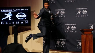 Florida State Jameis Winston poses for a photo after being awarded the 2013 Heisman Trophy at the Marriott Marquis in New York City.