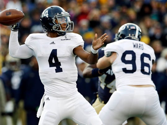 Georgia Southern quarterback Kevin Ellison (4) throws to a receiver as teammate Jeff Ward (96) blocks Navy linebacker Obi Uzoma in the first half of an NCAA college football game, Saturday, Nov. 15, 2014, in Annapolis, Md. (AP Photo/Patrick Semansky)
