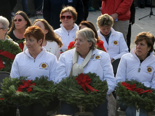Members of American Gold Star Mothers, Inc. accept wreaths from the Civil Air Patrol cadets of Maine during the Wreath Laying Ceremony presented by Wreaths Across America at the New Jersey Vietnam Veterans' Memorial in Holmdel, NJ Wednesday December 9, 2015.