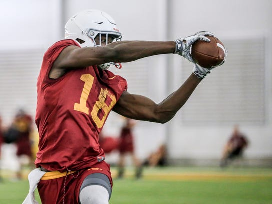 Iowa State's Hakeem Butler runs a drill in practice